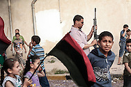 Children and women participate at a demonstration of morale support in Misrata streets. 22 May 2011.