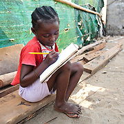 A girl does her homework in the West Point slum of Monrovia, Montserrado county, Liberia on Monday April 2, 2012.