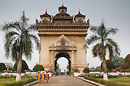 Visitors to the Patuxa or 'Victory Gate'. Built between 1957 and 1968. Patuxai is dedicated to those who fought for  independence from France