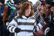 "SHOT 1/26/08 4:12:21 PM - Snowboarder Shaun White high fives fans as he signs autographs while walking towards the podium to accept a bronze medal in the Snowbaord Slopestyle event Saturday January 26, 2008 at Winter X Games Twelve in Aspen, Co. at Buttermilk Mountain. White finished third (83.33) behind Kevin Pearce (88.33) and Andreas Wiig (92.00). White did however win the Supeprpipe competition continuing his dominance in Winter X Games. The 12th annual winter action sports competition features athletes from across the globe competing for medals and prize money is skiing, snowboarding and snowmobile. Numerous events were broadcast live and seen in more than 120 countries. The event will remain in Aspen, Co. through 2010.Shaun Roger White (born September 3, 1986 in Carlsbad, California) is an American athlete. He has been a notable competitor in professional snowboarding since he was fourteen years old, but is also known for his skateboarding. He is known for his shock of red hair, for which he has become known as ""The Flying Tomato"". White gained sponsorship from Burton after his mother phoned them to see if they had a board small enough for her 6-year-old son..(Photo by Marc Piscotty / © 2008)"
