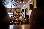 Tim Schmidt tells a humorous story of Greyhound travel during the Johnson Public House Story Night, Friday, September 26, 2014