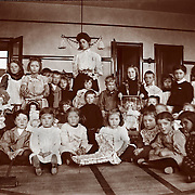 Vintage Photo: Kids and their teacher in a classroom with toys, 1906.Clayton School Milwaukee. education, kids, play, school.