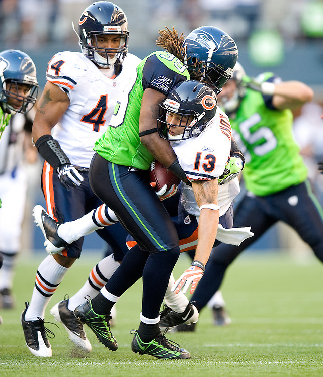 SEATTLE SEAHAWKS VS CHICAGO BEARS - Seattle's C.J. Wallace punishes Chicago return specialist Johnny Knox on a kickoff return in the second half.