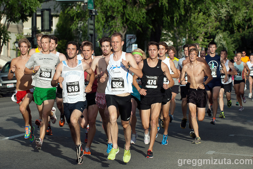 A tight pack (L to R: Morgan Choate, Dominic Bolin, Barak Watson, Max Hampton, Scott Foley, Rob Versaw, Sawyer Bosch, Zach Wiles) 200 meters into the Key Bank Open Mile during the Main Street Mile sponsored by Saint Alphonsus in downtown Boise, Idaho on June 22, 2012. Bosch won the race in 4:20.3 followed by Watson (4:20.6) and Foley (4:22.7)