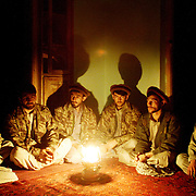 Northern Alliance commanders in Farkhar, Afghanistan meet to plan their next move as U.S. planes begin their assault on Taliban positions in this October 2001 photo.