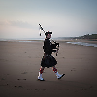 A pipe player on Omaha beach the morning of the 6th June celebrating the 69th anniversary of the D Day