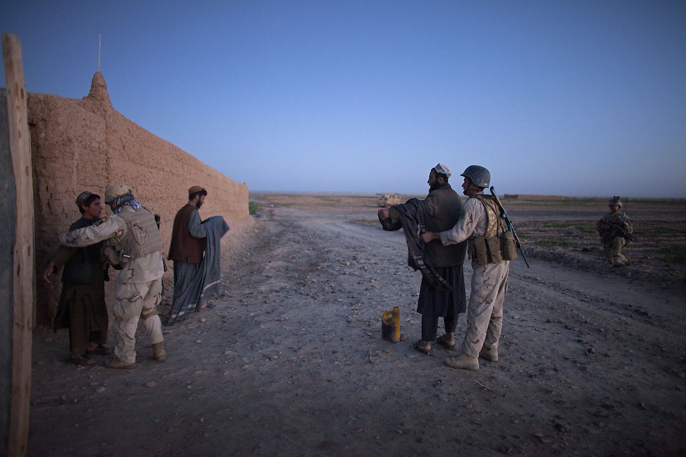 Members of the Afghan Special Forces seach and question local Afghans in an early morning raid as part of  a joint operation with British soldiers of 16 Air Assault Bde's elite BRF (Brigade Reconnaissance Force)  n the Western Dasht, Helmand Province, Southern Afghanistan on the 20th of March 2011.