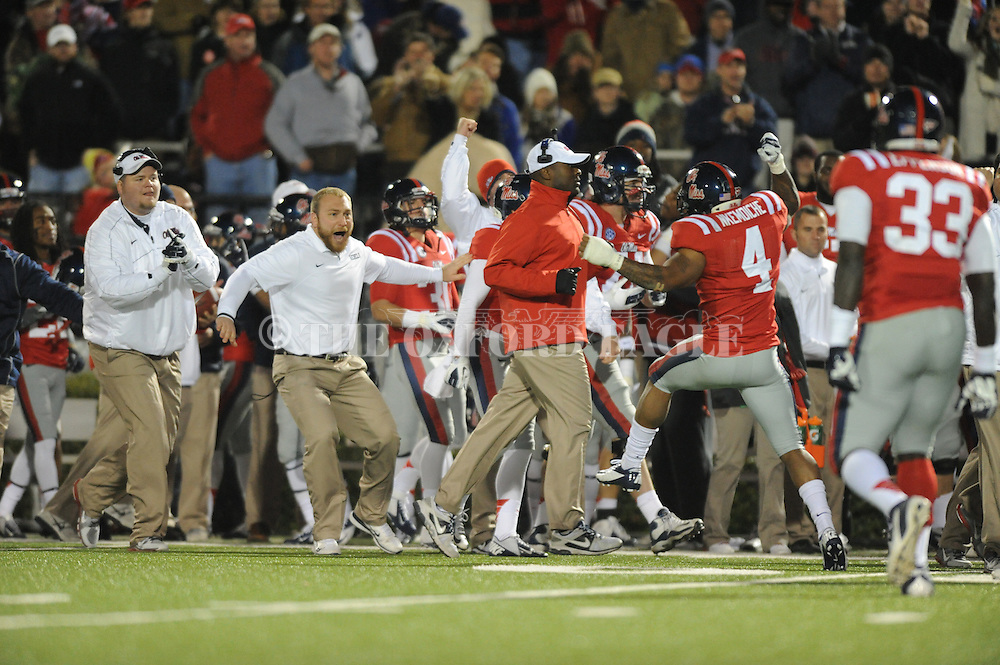 The Ole Miss bench reacts to the Rebels stopping Mississippi State on 4th down at Vaught Hemingway Stadium in Oxford, Miss. on Saturday, November 24, 2012. Ole Miss won 41-24.