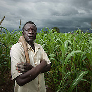 Maize farmer Kwame Eya, Upper West Region, Ghana. Climate change is reducing Eya's crop yields and changing rainfall patterns in the rainy season.