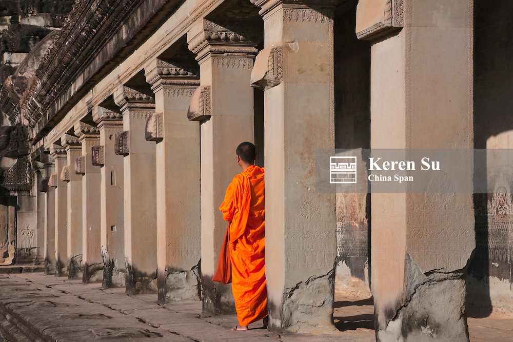 Monk in Angkor Wat, UNESCO World Heritage site.