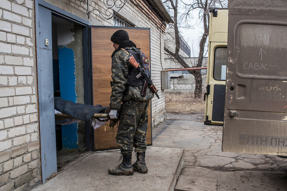 ARTEMIVSK, UKRAINE - FEBRUARY 14: The body of a Ukrainian soldier killed in fighting is brought into the morgue on February 14, 2015 in Artemivsk, Ukraine. A ceasefire between Ukrainian forces and pro-Russian rebels is scheduled to go into effect at midnight. (Photo by Brendan Hoffman/Getty Images) *** Local Caption ***