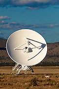 A Pronghorn Antelope grazes near one of the 27 antennas that make up the Very Large Array (VLA). The Plains of San Augustin in southwestern New Mexico.