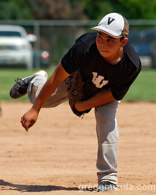 Keegan Mizuta pitches during the Vale-Payette game at the Snake River Slug Fest Baseball Tournament at Mesa Recreation Park in Fruitland, Idaho on July 27, 2013.