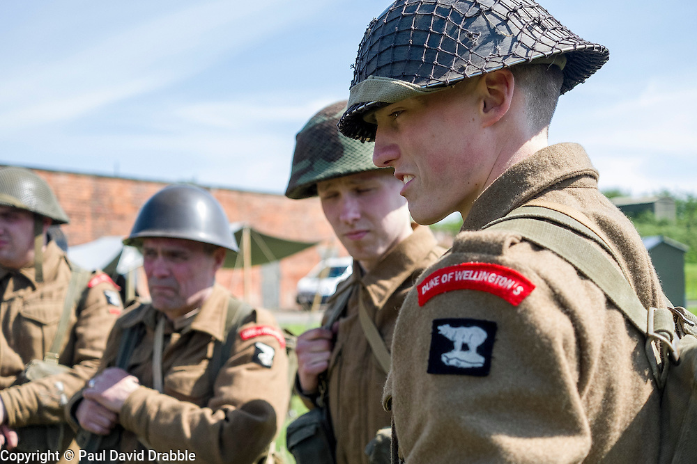 Reenactors from the Duke Of Wellingtons Regiment Living History Group wait to take part in a firing display <br /> <br />   04May 2015<br />   Image &copy; Paul David Drabble <br />   www.pauldaviddrabble.co.uk