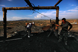 A picture made available on 05 July 2012 of Mongolian miners shoveling coal onto a truck at a coal mine in the mining town of Nalaikh in Mongolia, 02 July 2012. Once a thriving mining town, Nalaikh is one of first and oldest mining site in Mongolia but has seen a decline in its fortune as mining disasters and accidents plague the site. With little government oversight, only a handful of small companies and informal miners work on the site with scant regard to safety standards. Mongolia is rich in a variety of natural resources including forests, coal, iron ore, gold and copper. Expansion of the mining industry has turned the sector into the most important income source and led to an economic growth rate last year of around 17 per cent. The majority of raw materials are exported to China. Seeking to to reduce the dependency on China for exports and Russian imports, Mongolia has embarked on a policy of closer economic ties with other countries such as Germany, Canada and the United States. Despite impressive growth rates, about one-third of the population lives below the poverty line while unemployment and inflation are high.