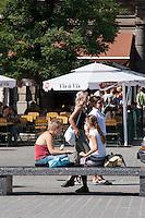 People relaxing on the Rynek in Krakow