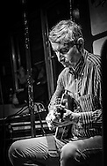 Sergio Piccarozzi playing the guitar on the TramJazz in Rome.