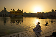 One of the most beautiful places in all the world has to be The Golden Temple in Amritsar, India. It's the most important temple of the Sikh religion, and an incredible place of peace and beauty. Sikh pilgrims come from all over the world to meditate here and are welcomed by open arms and incredible kindness. The site has a free dormitory (even for western visitors) and the cafeteria serves 20,000 free meals a day.  Originally a lake known for it's beauty, that many, even the Buddha, came to meditate at. The temple in the middle of the lake was completed in 1604. It has unfortunately been the site of many battles involving the Sikhs, but remains a place of peace.  As you walk around the lake, barefooted and listening to the peaceful music and nonstop reading of the Sikh holy verses, you're greeted warmly by pilgrims and local Sikhs, all happy to see foreigners enjoying their place of peace.