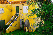 SHOT 3/17/11 7:21:55 AM - One of the many colorfully painted home in Willemstad. Willemstad is the capital city of Curaçao, an island in the southern Caribbean Sea that forms a constituent country of the Kingdom of the Netherlands. Formerly the capital of the Netherlands Antilles prior to its dissolution in 2010, it has an estimated population of 140,000. The historic centre of the city consists of two quarters: Punda and Otrobanda. The city center of Willemstad boasts an array of colonial architecture that is influenced by Dutch styles. The city center, with its peculiar architecture and beautiful harbour entry, has been made a UNESCO world heritage site. (Photo by Marc Piscotty / © 2010)