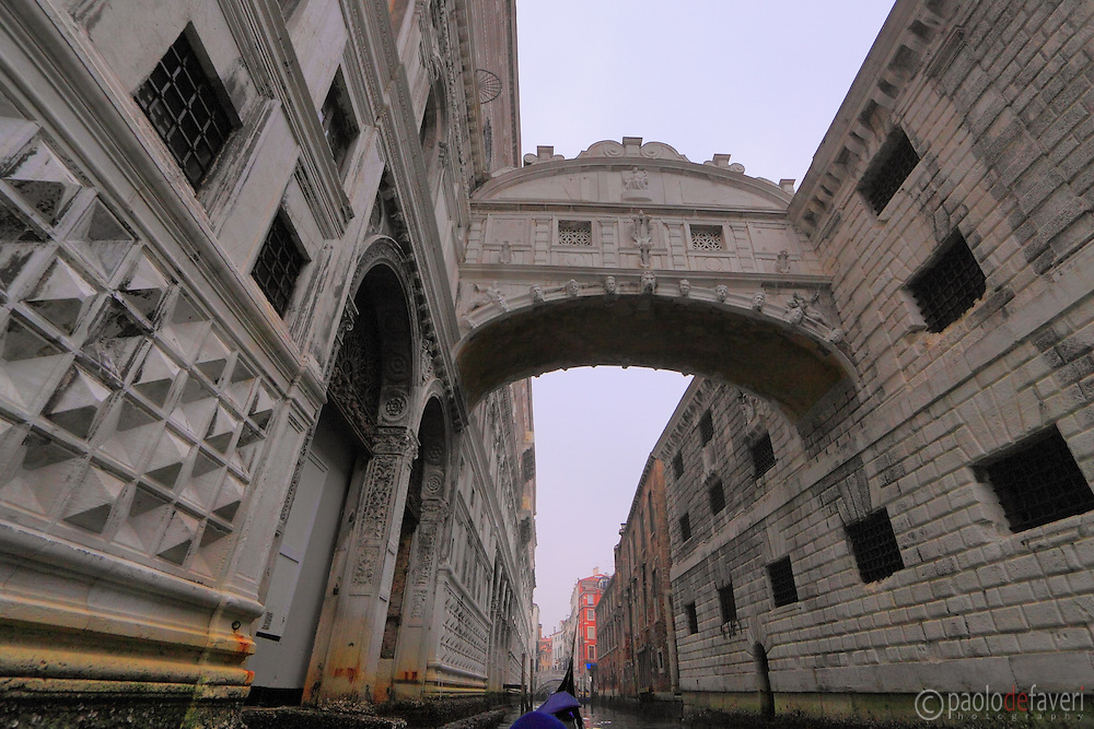 An unusual view from elow of the Bridge of Sighs, the Doge's Palace and the Piombi. Taken from aboard a gondola.