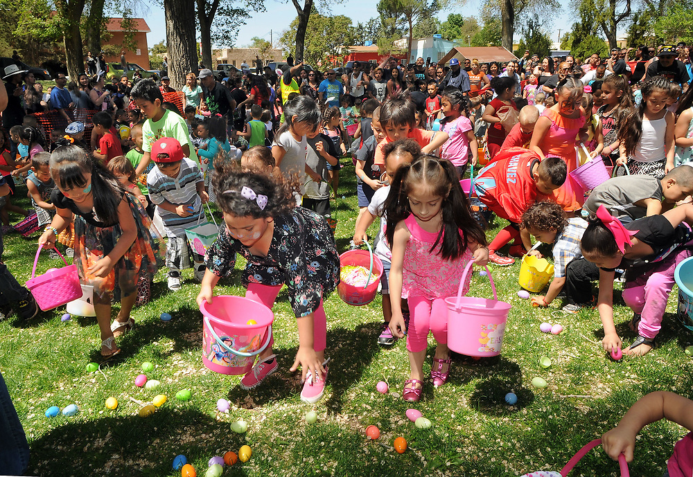 jt041517k/a sec/jim thompson/  The first group of kids ages 3-5  hit the field of easter eggs at the Victory Outreach Albuquerque Church's HOPE Easter Egg Hunt and care Basket Giveaway at Roosevelt Park.  Saturday April 15, 2017. (Jim Thompson/Albuquerque Journal)