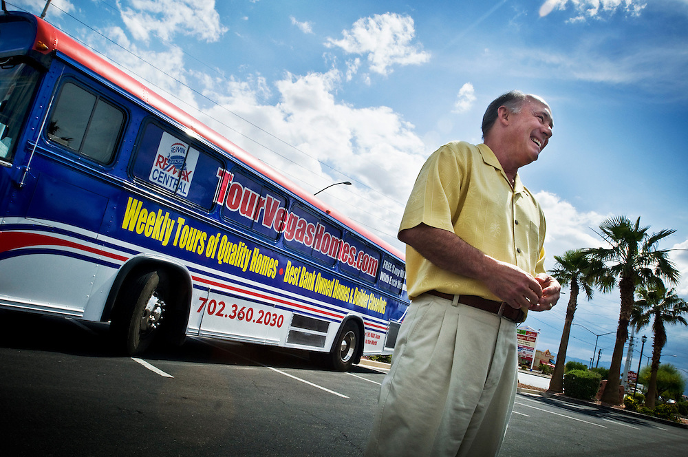 """Greyhound trip..Foreclosures in Las Vegas - John Ahlbrand at Remax in Las Vegas takes interested buyers on """"Foreclosure Tours"""" in a bus that tours bank-owned properties...Photographer: Chris Maluszynski /MOMENT"""