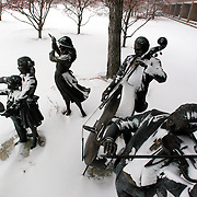 "The orchestra plays on despite a fresh snowfall on the Drake University campus in Des Moines, Iowa.  The bronze sculpture, ""The Joy of Music"", by artist George Lundeen, sits in front of the Fine Arts Building."
