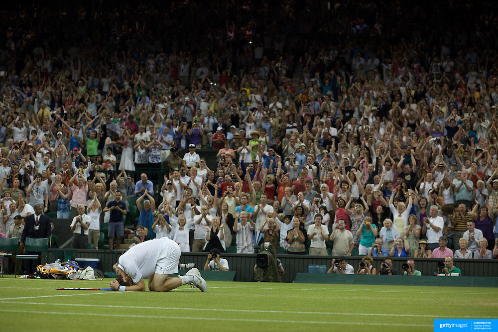 Andy Murray, Great Britain, falls to his knees after winning a marathon five set match against Stanislas Wawrinka , Switzerland, at the All England Lawn Tennis Championships at Wimbledon, London, England on Monday, June 29, 2009. Photo Tim Clayton.