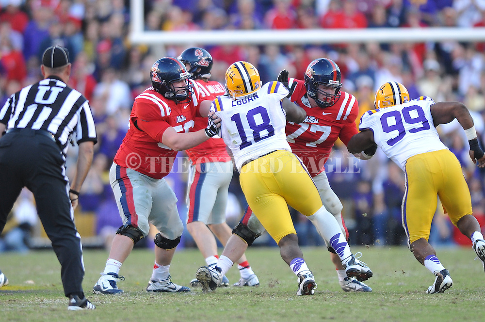 Ole Miss center Evan Swindall (56) and Ole Miss offensive lineman Patrick Junen (77) vs. LSU at Tiger Stadium in Baton Rouge, La. on Saturday, November 17, 2012.....