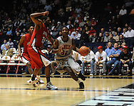 "Ole Miss' Jarvis Summers(32) vs. Louisiana-Lafayette's Darshawn McClellan (21) at C.M. ""Tad"" Smith Coliseum in Oxford, Miss. on Wednesday, December 14, 2011. (AP Photo/Oxford Eagle, Bruce Newman)"