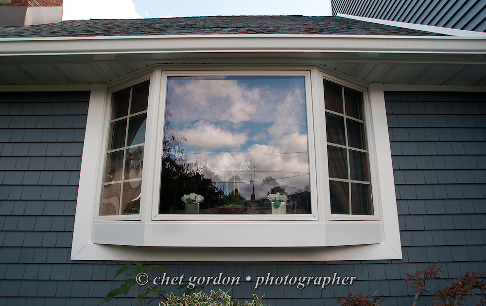 The new bay window, trim and siding of Craig Furer's Cranford, NJ home on Sunday, October 23, 2016. Furer and his wife Jen hired Magnolia Home Remodeling Group to complete a full exterior makeover. The company replaced the siding with shake and clapboard, added various architectural accents, replaced the roof, modified the roofline, built a front portico and replaced two windows. Craig spent a lot of time researching this project before it began and is thrilled with the overall result.  © Chet Gordon for Angie's List