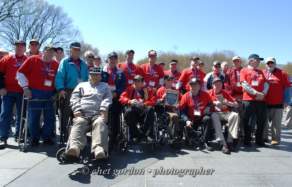 WWII Veterans and their escorts onboard the Hudson Valley Honor Flight at the Korean War Memorial in Washington, DC on Saturday, April 11, 2015. Nearly 100 Veterans from the Orange County (NY) region toured the WWII, Korean, Vietnam, and USMC War Memorials, as well as Arlington National Cemetery. Hudson Valley Honor Flight is a chapter of the Honor Flight Network, which provides free flights for WWII Veterans and tours of the WWII Memorial constructed in their honor, and other sites in the nation's capital.  © Paul Rader for Hudson Valley Honor Flight