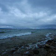 &quot;Rocky Shores at McGulpin Point&quot;<br /> <br /> Beautiful dark and moody storm clouds envelope the straits of Mackinac with a view of Mackinac Bridge in the distance!!<br /> <br /> Mackinac Bridge by Rachel Cohen