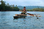 Ni Vanuatu boy fishing in a lagoon at South West Bay, Malekula, Vanuatu