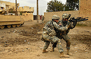 U.S. Army Spec. William McGrath and Spec. Daniel Brothers  launch a grenade toward enemy fighters after coming under fire in Buhriz, Iraq, on Feb. 15, 2007.