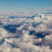 Glacier Peak, a 10,541-foot (3,213-meter) volcano in Washington state, rises above a layer of clouds that obscures lower peaks in the Cascade Range. Glacier Peak, also known as Takobia, is one of Washington's most active volcanoes, erupting five times over the past 3,000 years. It also ranks as the state's fourth-tallest mountain.