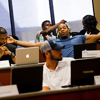 MIAMI, FL - June 24, 2015 -- Former NFL player Tutan Reyes participates in a Legal & Ethical Implications of Executive Decision Making class taught by Professor Patricia Abril at the University of Miami as part of their Miami Executive MBA for Artists & Athletes program on Wednesday, June 24, 2015.  (PHOTO / CHIP LITHERLAND)
