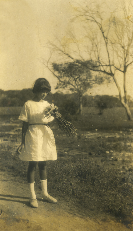 Christine Spittel with Lotus flowers.<br /> R.L. Spittel Collection