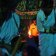A group of Devadasi women worship the goddess, Yellamma, at a temple in Maharashtra, India.