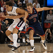 Gonzaga's Elias Harris and Saint Mary's Mitchell Young battle for the ball.