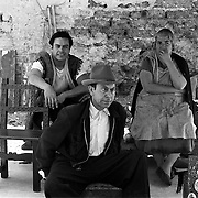 Cross-eyed man with his wife and son, seated in marketplace. Taken in 1962 in Mexico City with a 35 mm NIkon FM.