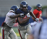 Ole Miss' Jamal Mosley (17) catches a pass and is tackled by Rudy Wilson (31) during a team scrimmage at Vaught-Hemingway Stadium in Oxford, Miss. on Saturday, August 20, 2011.