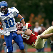 Coe defensive back Kyle Polich (9) tackles Dubuque quarterback Colton Hansen (10)during the first half at Coe College in Cedar Rapids on October 3, 2009. (Crystal LoGiudice/The Gazette). ..
