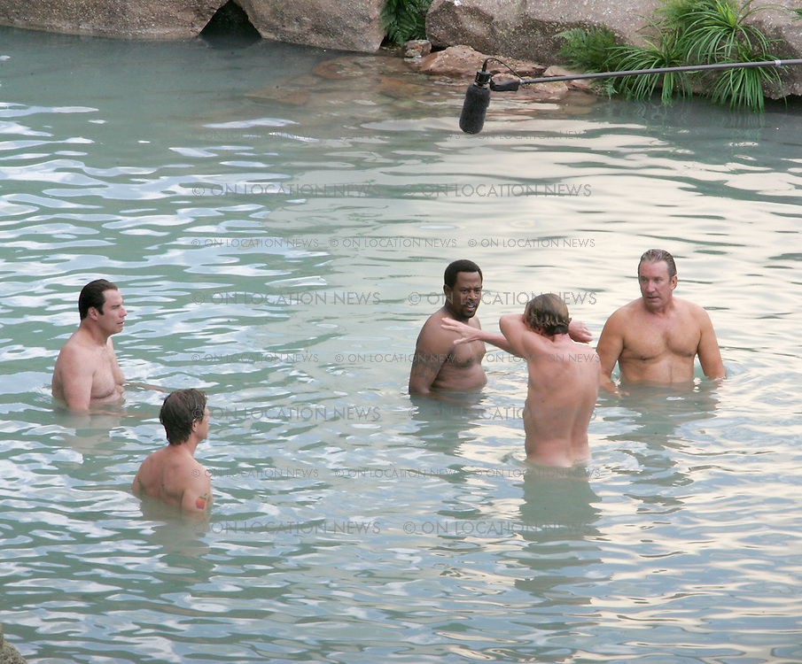 ***EXCLUSIVE***<br /> John Travolta and his co stars filming a nude skinny dipping scene for &quot;Wild Hogs&quot; in 2007. Travolta is being sued by two unnamed male masseurs -- John Does No. 1 and 2 -- who both claim the actor tried to have sex with them during massage sessions. <br /> Photos by Eric Ford/ On Location News info@onlocationnews.com 818-6133955