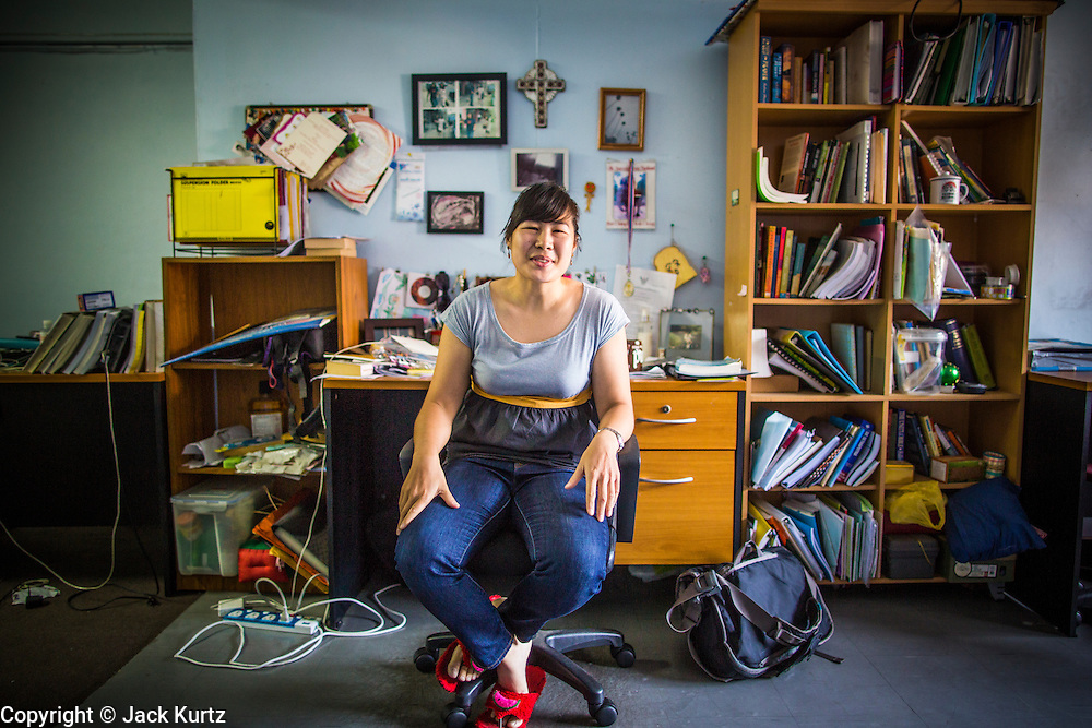 28 MARCH 2013 - BANGKOK, THAILAND: Michelle Kao in the Thai Peace Foundation office.     PHOTO BY JACK KURTZ