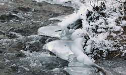 Severe frosts form ice on a riverbank near Queenstown, New Zealand, Monday, July 09, 2012.