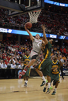 Ohio State guard Aaron Craft (4) is fouled as he drives to the basket in OSU's 98-66 win against George Mason in the third round of the NCAA Tournament on March 20, 2011, in Cleveland.