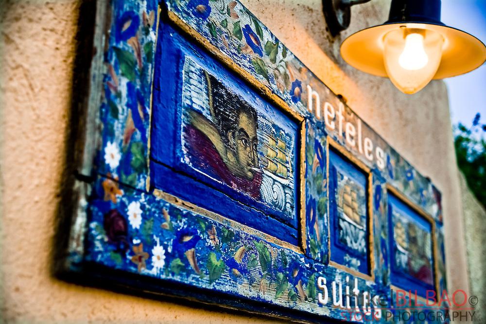 Hotel sign.<br /> Fira village. Santorini island, Cyclades islands, Aegean Sea, Greece, Europe