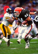 CLEVELAND, OHIO-OCTOBER 11:  Tommy Vardell of the Cleveland Browns runs with the football during an NFL game against the Pittsburgh Steelers on October 11, 1992 at Municipal Stadium in Cleveland, Ohio.  (Photo by Ron Vesely)