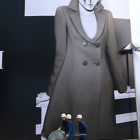 Mingongs - migrant workers - put a finishing touch to Shin Kong place shopping mall in Beijing. 2007